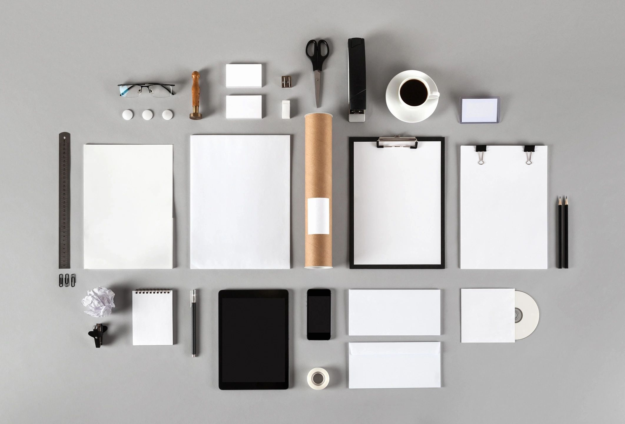 overview of a desk with paper goods and coffee